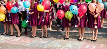 Lifestyle concept -high school graduates hold balloons in their hands royalty free stock photography