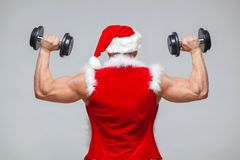Holidays and celebrations, New year, Christmas, sports, bodybuilding, healthy lifestyle - Muscular handsome sexy Santa. Claus Royalty Free Stock Images