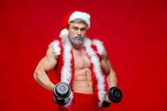 Holidays and celebrations, New year, Christmas, sports, bodybuilding, healthy lifestyle - Muscular handsome sexy Santa Royalty Free Stock Image