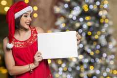 Holidays, Christmas. Portrait of smiling woman wearing Santa hat Stock Photo