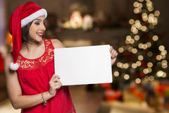 Holidays, Christmas. Portrait of smiling woman wearing Santa hat Royalty Free Stock Photography