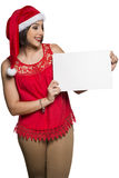 Holidays, Christmas. Portrait of smiling woman wearing Santa hat Stock Photos