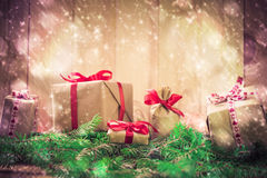 Holidays coming snowing Christmas gifts needles Royalty Free Stock Photo