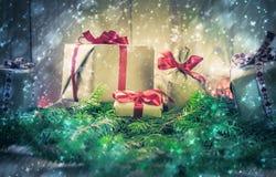 Holidays coming snowing Christmas gifts needles Royalty Free Stock Photos