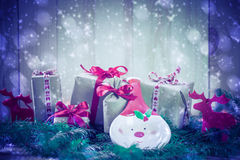Holidays coming snowing Christmas gifts reindeer needles Stock Photos
