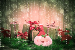 Holidays coming snowing Christmas gifts reindeer needles Royalty Free Stock Photography