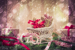Holidays coming snowing Christmas gifts sleigh needles Royalty Free Stock Image