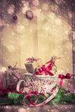Holidays coming snowing Christmas gifts sleigh needles Stock Photo