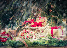 Holidays coming snowing Christmas gifts sleigh needles Stock Images
