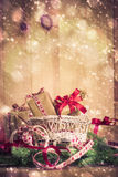 Holidays coming snowing Christmas gifts sleigh needles Royalty Free Stock Photography