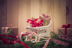 Holidays coming snowing Christmas gifts sleigh needles Stock Image