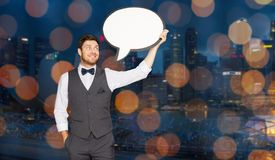 Man with blank text bubble over singapore city. Holidays and communication concept - happy man in suit holding blank text bubble banner over singapore city night Stock Images