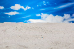 Holidays concept with bright blue sky, white sand Royalty Free Stock Photo
