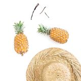 Holidays concept. Pineapple fruits, sun glasses and straw hat on white background. Flat lay, top view. Stock Photos