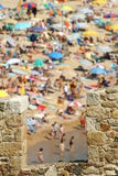 Holidays in Costa Brava. Holidays on crowded beach in Costa Brava Spain Stock Photography