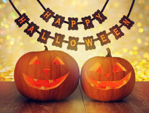 Carved pumpkins and happy halloween garland Royalty Free Stock Images