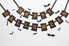 Happy halloween party garland decoration and bats. Holidays, decoration and party concept - happy halloween festive paper black garland or banner with bats over Royalty Free Stock Photo