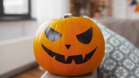 Jack-o-lantern pumpkin at home on halloween stock video