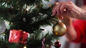 Senior woman hands decorating christmas tree stock video