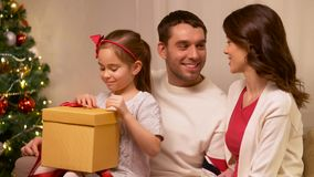 Happy family with christmas present at home stock video