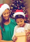 Happy mother and daughter with christmas gift royalty free stock images