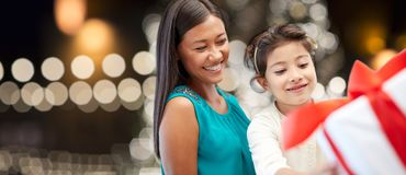 Happy mother and daughter with christmas gift Stock Image