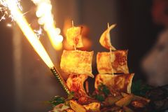 Holidays fire burning dish. Beautiful serving dish with fire Royalty Free Stock Image