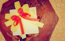 Holidays gift box with ribbon vintage style. Holidays gift box with ribbon on wooden background Royalty Free Stock Photo