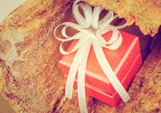 Holidays gift box with ribbon vintage style. Holidays gift box with ribbon on wooden background Stock Photography