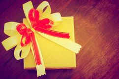 Holidays gift box with ribbon vintage style Royalty Free Stock Images