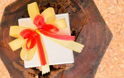 Holidays gift box with ribbon. On wooden background Royalty Free Stock Images