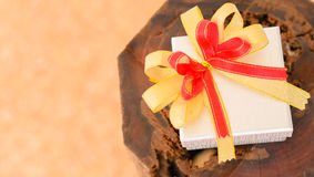 Holidays gift box with ribbon. On wooden background Royalty Free Stock Image