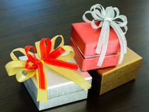 Holidays gift box with ribbon. On wooden background Royalty Free Stock Photo