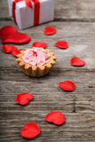 Holidays gift, cake and red heart Royalty Free Stock Photo
