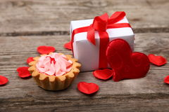 Holidays gift, cake and red heart Stock Image
