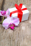 Holidays gift and orchid Stock Photo