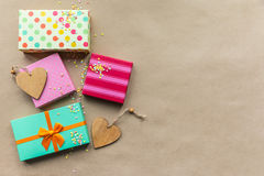 Holidays giftboxes on the craft paper background. For Stock Image