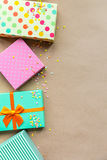 Holidays giftboxes on the craft paper background. For Royalty Free Stock Photography
