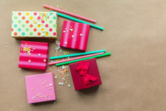 Holidays giftboxes on the craft paper background. For Royalty Free Stock Photo