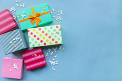 Holidays giftboxes on the pastel blue background. For Royalty Free Stock Photo