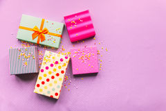 Holidays giftboxes on the pastel pink background. Holidays giftboxes on the craft paper background for Stock Photography