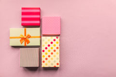 Holidays giftboxes on the pastel pink background. For Royalty Free Stock Images