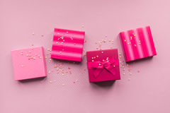 Holidays giftboxes on the pastel pink background. For Royalty Free Stock Photos
