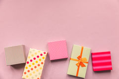 Holidays giftboxes on the pastel pink background for. 