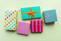 Holidays giftboxes on the pastel yellow background. For Stock Photography