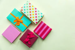 Holidays giftboxes on the pastel yellow background. For mother`s day, christmas, birthday Stock Photography