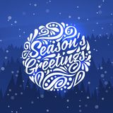 Seasons Greetings. Holidays greeting card. Holidays greeting card with typography on background of night forest. Seasons Greetings Royalty Free Stock Image