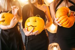 Close up of woman with pumpkins at home stock photography