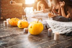 Close up of woman with pumpkins at home stock photo
