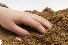Holidays. Hand that has buried the fingers in the sand Royalty Free Stock Photo
